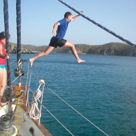 Caribbean Sailing Charters | Bruce jumping for joy at Jost Van Dyke BVI