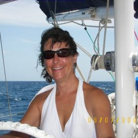 Caribbean Sailing Charters | Jennifer at helm in BVI