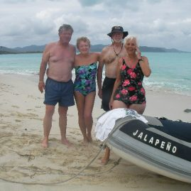 Caribbean Sailing Charters | Dinghy to the beach. Sandy Cay, British Virgin Islands