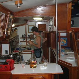 Caribbean Sailing Charters | Preparing dinner in the galley